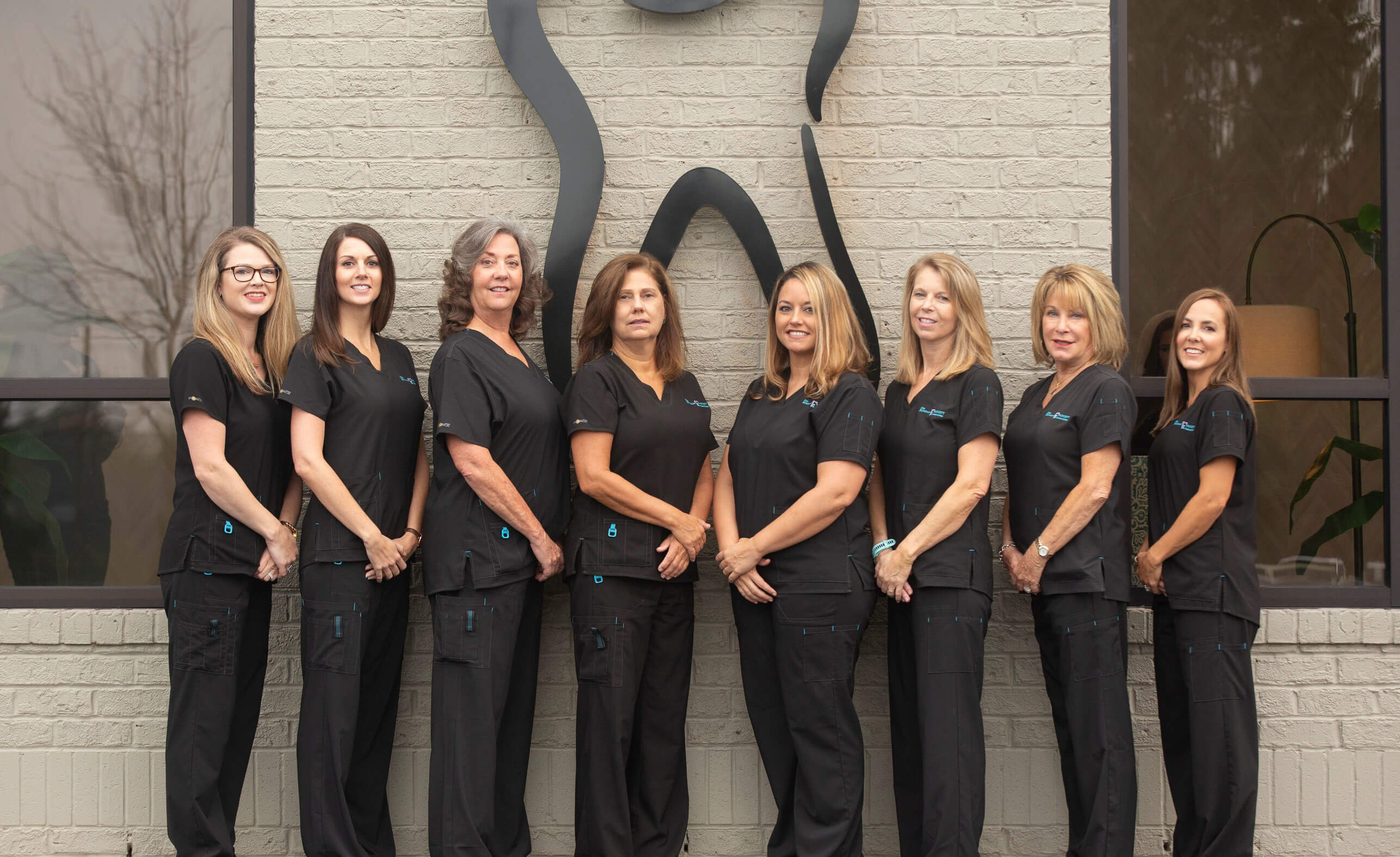 The Dental Hygiene Team Standing Together